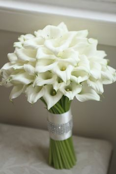 Bouquet of white calla lilies. Liberty Blooms.