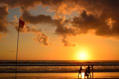 Models and photographer on the beach at sunset by Julien Boé on 500px
