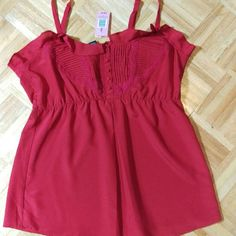 Torrid Red Empire Waist Tank - Size 1 Torrid Red Empire Waist Tank - Size 1. Silky red, with a pleat in the front. Buttons and crochet. Brand new with tags, never worn. torrid Tops