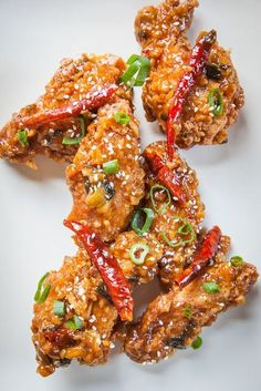 These sticky sweet and spicy General Tso's chicken wings are inspired by the classic Chinese-American General Tso's Chicken. Seriously addictive! (Jump directly to the recipe.)