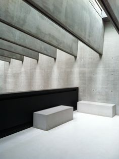 Massive concrete beams + bench. Perfect in situ concrete walls with exposed spacers. Amazing skylight between deep thin concrete beams. Monochrome interior space. Black white concrete pure forms.