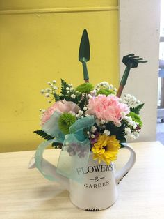 Spring mixed bouquet in ceramic watering can.