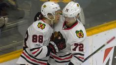 After setting him up on the empty-net goal, Patrick Kane tried to kiss Artemi Panarin, but the Russian winger wasn't having it.
