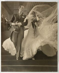 Isn't this photo charming? The 1930s wedding dress is beautiful and it's captured a really nice moment as the veil tries to fly away! The people in the photo are musical stars Madge Elliott and Cyril Ritchard who married at St Mary's Cathedral, Sydney on 16 September 1935.