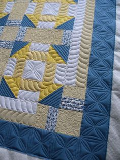 perfectly spaced feathers. Border has double/triple triangles quilted in for high texture.