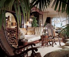 """Asian home decor. Owner's """"favorite meditation spot"""" is the living room's circa 1920 Chinese opium bed. A Burmese reclining Buddha is at the window in the dining room, whose table is set with Tiffany's crystal and china."""