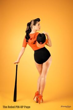 I would totally get this as a pin up tattoo, but she'd be wearing an old school skirted softball uniform