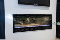 """Check out this gorgeous Prism Installation on """"Property Brothers: Buying & Selling"""" episode 409 - Derek & Melanie Jonathan Scott, Property Brothers, Electric Fireplace, Baseboards, Open Concept, Floor Plans, Entertaining, Basement, Check"""