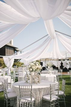 This crazy beautiful white and silver Florida #wedding from Paul Johnson Photography makes me weak in the knees! To see more gorgeous details: http://www.modwedding.com/2014/06/06/chic-florida-wedding-from-paul-johnson-photography/ #wedding #weddings #centerpiece #reception