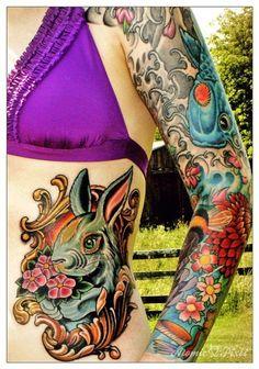 Rabbit tattoo, koi and flowers. Amazing colors. #tattoo #tattoos #ink
