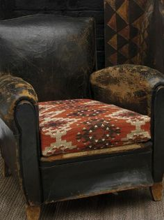 Andrew Martin - Orinoco Fabric Collection - Footstool in dark red with cream, red and brown Aztec-like pattern.