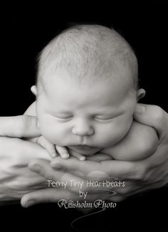 Little newborn photography girl in farther hands with parents