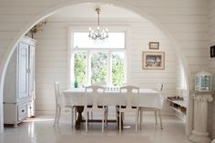 use the archway to frame the table and light - nice.
