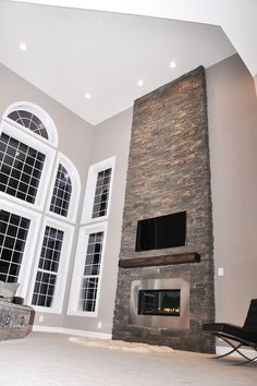 floor to ceiling stone fireplace; what a statement! Perfect for this space.