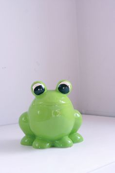This piggy bank makes a great gift for a school aged child. Vintage ceramic bank green frog kids piggy bank by fuzzymama on Etsy