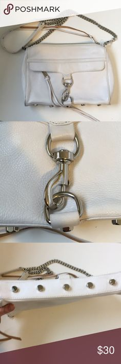 Rebecca Minkoff White Mac Leather Crossbody Bag Rebecca Minkoff MAC Crossbody Bag with chain strain strap in white leather.  This purse was well-loved and shows definite signs of wear, which is reflected in the low price compared to retail.  There are signs of wear or staining along exterior leather including the corners and the back part of the bag that hit my hip.  There's some cracking in the leather of front like the flap. Some scratching on Hardware.  The interior is in pretty good…
