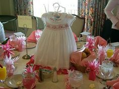 Cute baby shower centerpiece. I love decorations that can be reused or given to the mom as gifts after the shower.