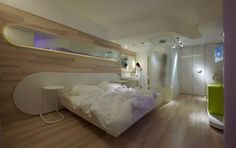 Interior. Baffling Design Modern Hotel Room Interior Ideas. Beautiful Design Hotel Room Interior Ideas comes with Oval Shape White Headboard Panels. White Wooden Bed Frame and White Covered Bedding Sheets