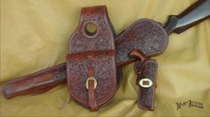 Any cowboy would be thrilled to own this matching set. Full floral tooling, lined carbine scabbard, lined saddle/belt holster for any large frame single six and 9 x 9 saddle pockets, back lined and all with matching brass hardware. Leather Holster, Leather Tooling, Tooled Leather, Cowboy Crafts, Western Holsters, Pink Guns, Cowboy Pictures, Lever Action Rifles, Cowboy Gear