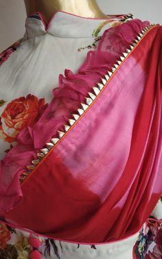Best 12 Red pink Shibori Ruffle Saree with Designer Floral blouse by Label Kanupriya Kurti Neck Designs, Dress Neck Designs, Kurta Designs Women, Saree Blouse Designs, Salwar Designs, Dress Indian Style, Indian Wear, Indian Saris, Shibori Sarees