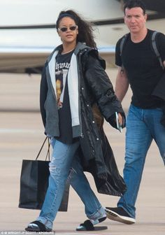 Christmas trip: Rihanna jetted into her native Barbados on Friday to spend the holidays with friends and family. But she found the time to unfollow BFF Jennifer Lopez, who is rumoured to be dating her ex, Drake