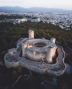 Bellver Castle in Mallorca, Spain. This unusual gothic castle was built in the century on a hill. It was inspired by Herodion - a… Beautiful Castles, Beautiful Buildings, Beautiful Places, Gothic Castle, Medieval Castle, Castle House, Castle Ruins, Places Around The World, Around The Worlds