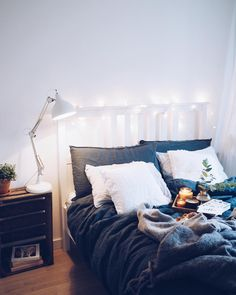 This just looks so cozy and inviting, which is how I want my bed to look