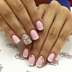 French manicure with rhinestone details.