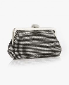 Black Crystal Clutch This clutch gets a healthy dose of crystals, while a silver drop-in chain makes for styling versatility. This clutch adds an exquisite touch to your night out! #handbag #clutch #style #fashion #fallfashion #lilyrain #justin