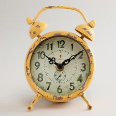 One of my favorite discoveries at WorldMarket.com: Yellow Vintage-Style Magnet Clock