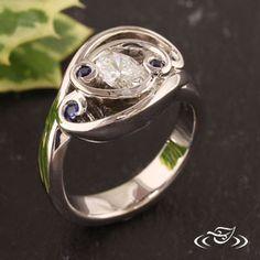 Custom palladium wrap swirl diamond sapphire ring