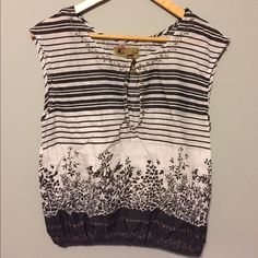 Free People Top Excellent condition, no flaws. Pretty embroidered details around neckline and gathered bottom. Keyhole opening in front. Flattering, cool and comfy!  100% cotton. Free People Tops