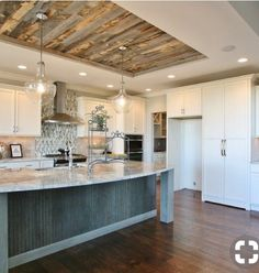 Always drawn to wood planks on the ceiling and mix of neutrals.  I can just picture the backs of upholstered bar stools to add a punch of color.