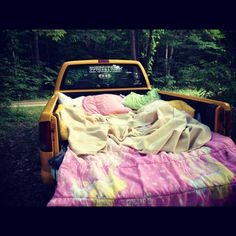 truck bed...that would be like a perfect date night under the stars or by a bonfire just chillin with beer!