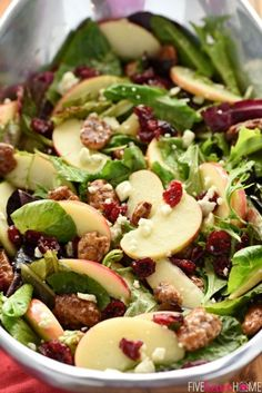 Holiday Honeycrisp Salad ~ full of flavor and texture, this gorgeous salad is loaded with fresh apple slices, crunchy candied pecans, chewy dried cranberries, and salty blue cheese, all dressed with a tangy-sweet apple cider vinaigrette atop a bed of your favorite salad greens...so vibrant and tasty you'll want to make it an annual addition to your Thanksgiving or Christmas menu! | http://FiveHeartHome.com