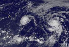 Hurricane Iselle, with 90 mph winds, and Hurricane Julio, with 75 mph winds, steam west-northwest towards the Hawaiian Islands in this GOES-West image taken at 8 pm EDT Wednesday, August 6, 2014.