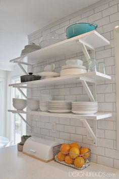 open shelves and subway tile  diy kitchen renovation before and after on DESIGN + LIFE + KIDS