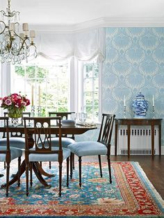 """Love the """"Lotus"""" wallpaper by Farrow & Ball, especially in this blue colorway. & Especially nice against the turquoise and rich red Persian rug."""