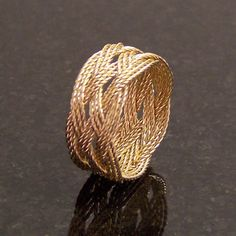 14k Gold Wire Ring Celtic Trebled Turk's Head Knot Faerie Middle Earth Elven Hand Made by CelticMysterium on Etsy https://www.etsy.com/listing/177322421/14k-gold-wire-ring-celtic-trebled-turks