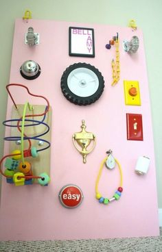 Playroom Inspiration:  DIY Busy Board This sensory busy board is part of a playroom made for an almost toddler that was put together on a budget. It looks beautiful and is a great lesson in re-purposing everyday items for play.