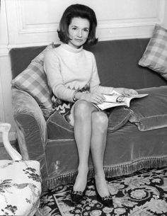 Portrait of American Princess Lee Radziwill, sister of Jaqueline Kennedy, sitting on a couch, 1960s