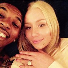 Iggy Azalea's new engagement ring - 8.15 ct. fancy yellow cushion cut center stone in 18k white gold.