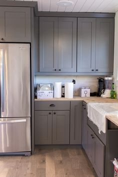 Oak trim melamine cabinets and cabinets on pinterest for Adding knobs to kitchen cabinets