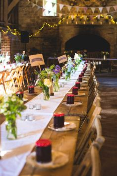 Rustic Trestle Table Setting with Jam Jars Filled with Wild Flowers as Centrepieces | Rustic Barn Wedding | Vintage Fairground Theme | Images by Something Clicked Photography | http://www.rockmywedding.co.uk/bryony-nick/