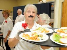 Pasta dinners and pancake breakfasts are staple fundraisers for many of our clubs. People keep coming back for seconds because of the delicious food, lively entertainment and the satisfaction of support the community. We found this week's photo at Ocala.com.    The Top of the World Lions Club hosted an Italian dinner fundraiser that featured karaoke, swing dancing and dressed-up wait staff. Here, Virginia Redden sports a fake mustache as she delivers Italian food.