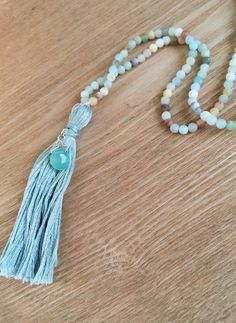 A personal favorite from my Etsy shop https://www.etsy.com/listing/290480533/boho-tassel-necklace-with-amazonite-with