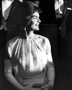 First lady and fashion icon, Jackie Kennedy, at JFK's inaugural ball on January 20, 1961. She wore a custom made silk chiffon dress designed by Ethel Frankau of Bergdorf Custom Salon. (Paul Schutzer—The LIFE Picture Collection/Getty Images)...
