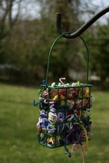 YARN BIRD FEEDER - This is so cool!!! Just add a couple of handfuls of yarn scraps to an inexpensive suet feeder and hang outside where the birds can find it. Then be on the lookout for birds nests in your neighborhood featuring your building materials.