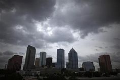 Dark clouds gather over the city skyline, near the site of the Republican National Convention in Tampa, Florida August 26, 2012. The convention begins August 28. REUTERS/Eric Thayer/Files