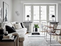 Few things are hotter than an all-white living room, and as far as we're concerned, this kind of clean minimalism isn't just for the Swedes anymore. Layering wh